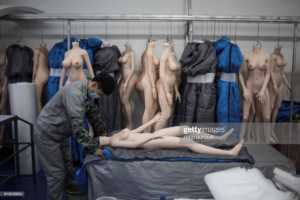 Graphic content / This photo taken on February 1, 2018 shows a worker preparing a silicone doll at a factory of EXDOLL, a firm based in the northeastern Chinese port city of Dalian. With China facing a massive gender gap and a greying population, a company wants to hook up lonely men and retirees with a new kind of companion: 'Smart' sex dolls that can talk, play music and turn on dishwashers. / AFP PHOTO / FRED DUFOUR / TO GO WITH China-sex-lifestyle, FOCUS by Joanna CHIU