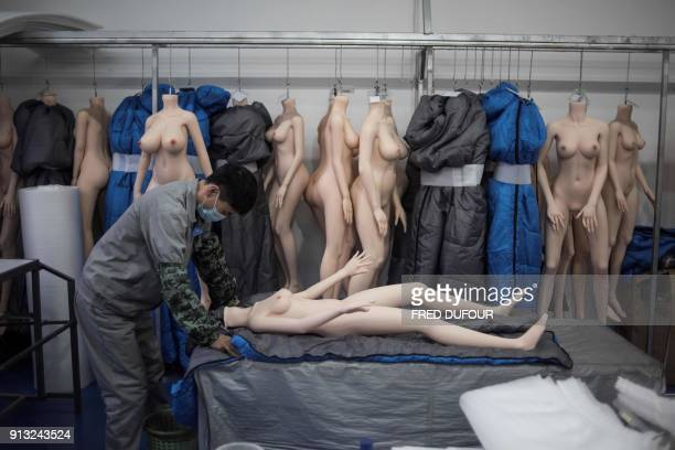 Graphic content / This photo taken on February 1 2018 shows a worker preparing a silicone doll at a factory of EXDOLL a firm based in the...