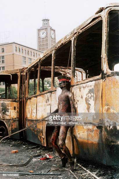 Graphic content / This photo taken on June 10 1989 in Beijing shows the naked and burnt body of a soldier hung on a city bus by an angry crowd which...