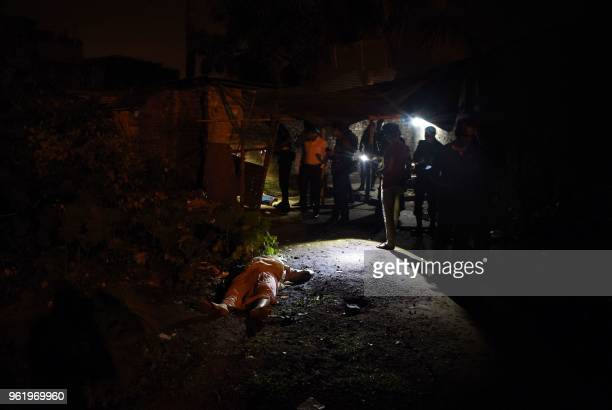 Graphic content / This photo taken on May 18 2018 shows the dead bodies of Bangladeshi alleged drug dealers after a gun battle with law enforcement...