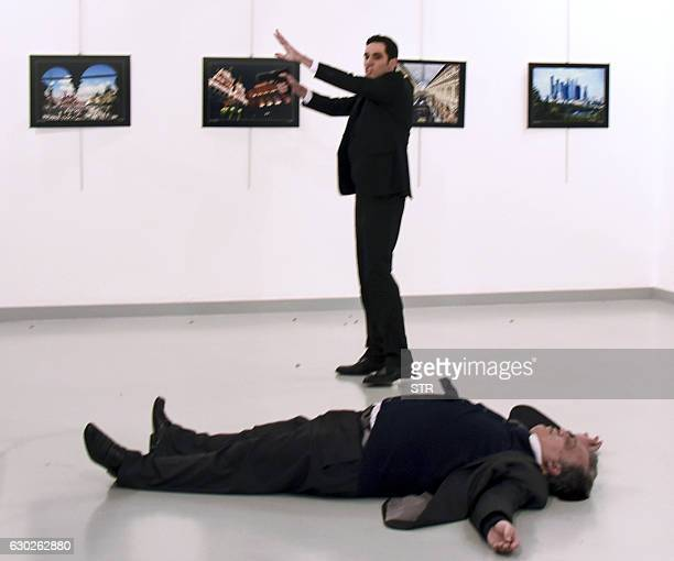 Graphic content / This picture taken on December 19 2016 shows Andrei Karlov the Russian ambassador to Ankara lying on the floor after being shot by...