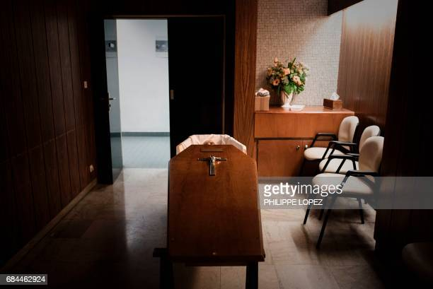 Graphic content / This picture taken on May 11 2017 shows a corpse in a coffin at the morgue of the Hospital Bichat Claude Bernard in Paris / AFP...