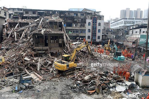 Graphic content / This picture taken on October 10 2016 shows rescuers searching for survivors at an accident site after four buildings caved in...
