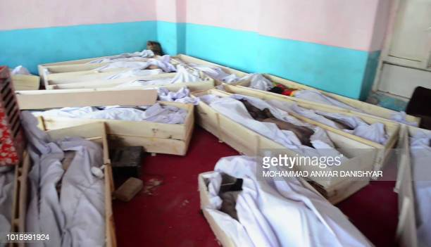 Graphic content / This screen grab taken from AFPTV video on August 13 2018 of video shot on August 12 shows dead bodies lying in coffins at Ghazni...