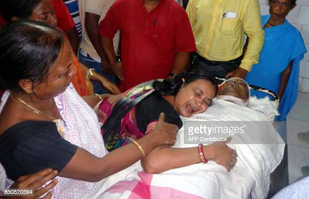 Graphic content / This September 20 2017 photo shows the mother of Indian journalist Shantanu Bhowmick weeping over his body at a hospital in...