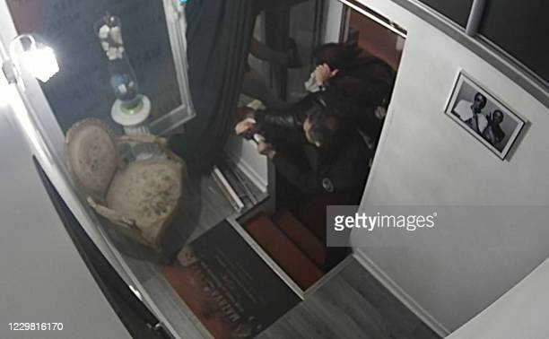 Graphic content / This video grab taken on November 27, 2020 from an AFP video shows CCTV camera footage, widely distributed on social networks,...