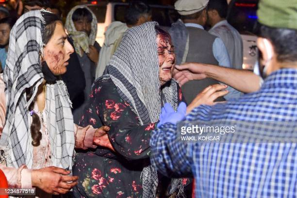 Graphic content / TOPSHOT - Wounded women arrive at a hospital for treatment after two blasts, which killed at least five and wounded a dozen,...