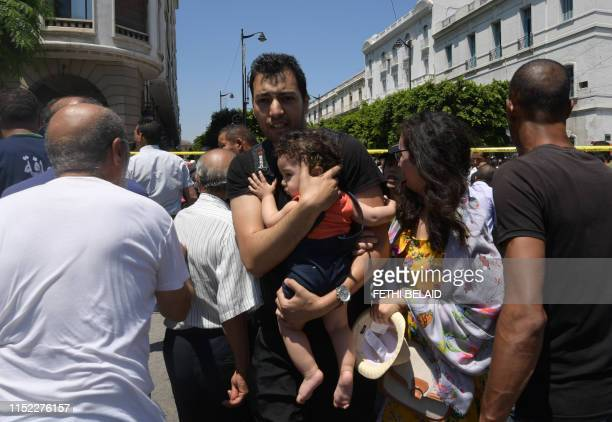 Graphic content / Tunisian civilians react at the site of an attack in the Tunisian capital's main avenue Habib Bourguiba on June 27 2019 A suicide...