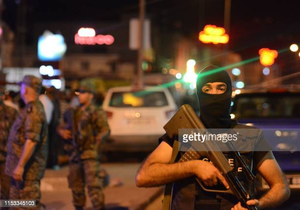 Graphic content / Tunisian security forces tighten security measures outside a metro station near the bus stop where a man reportedly wearing an...