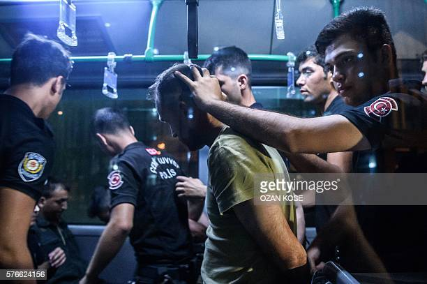 Graphic content / Turkish anti riot police officers detain a Turkish soldier who allegedly took part in a military coup as they are leaving in a bus...