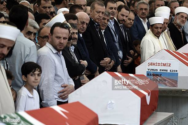 Graphic content / Turkish President Recep Tayyip Erdogan and former Turkish president Abdullah Gul attend the funeral of victims of the coup attempt...