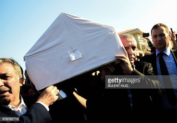 Graphic content / Turkish President Recep Tayyip Erdogan and former Turkish President Abdullah Gul carry the coffin of a victim of the coup attempt...