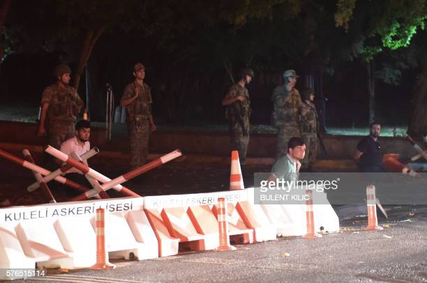 Graphic content / Turkish security officers detain unknown individuals on the side of the road on July 15 2016 in Istanbul during a security shutdown...