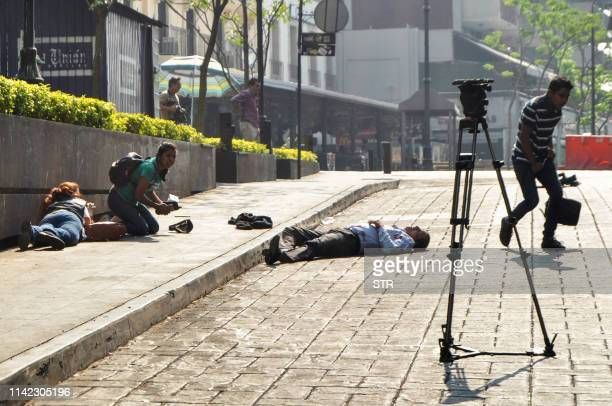 Graphic content / View of a crime scene moments after a gunman opened fire in the central square of Cuernavaca Morelos state in Mexico on May 8 2019...