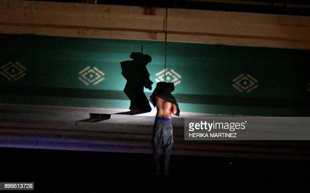 Graphic content / View of the body of a man who was found hanging from a vehicular bridge at the entrance to Ciudad Juarez Chihuahua state Mexico on...