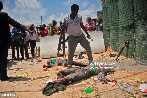 Graphic content / Weapons are gatheres from two dead militants suspected of being members of the alShabab in Mogadishu on April 16 2017 Somali...