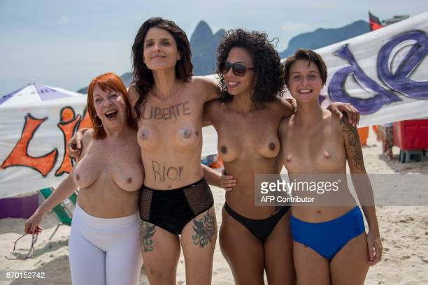 Graphic content / Women go topless to protest against censorship in Brazilian art at Ipanema beach in Rio de Janeiro Brazil on November 4 2017 / AFP...