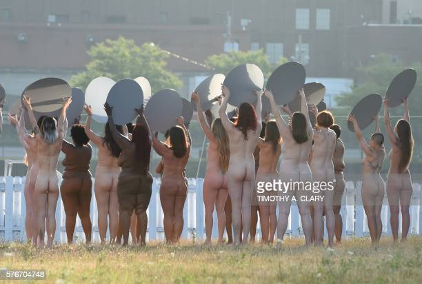 Graphic content / Women participate in a photo shoot by artist Spencer Tunick in his latest largescale art installation Everything She Says Means...