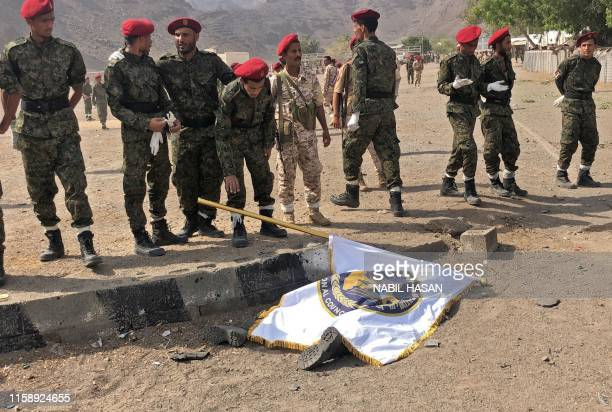 Graphic content / Yemeni security forces gather at the scene of a missile attack on a military camp west of Yemen's government-held second city Aden,...