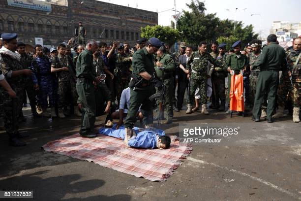 Graphic content / Yemeni security forces prepare to execute a man convicted of raping and murdering a fouryearold girl in the capital Sanaa's Tahrir...