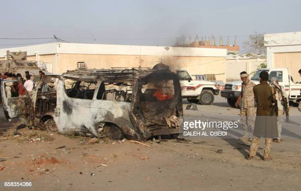 Graphic content / Yemenis check a burning vehicle following a reported suicide car bombing in Huta the capital of the southern province of Lahj a...