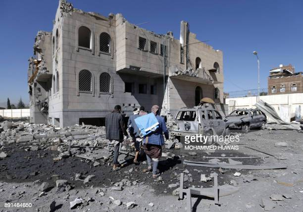Graphic content / Yemenis check the site of air strikes at a Huthirun detention centre in the capital Sanaa on December 13 2017 Saudiled air strikes...