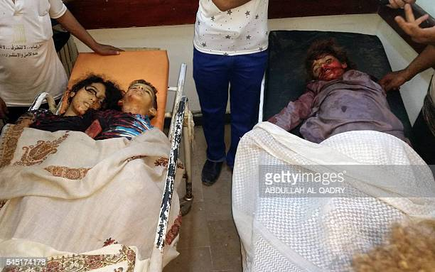 Graphic content / Yemenis stand next to the bodies of children killed by a rocket fired by Iranbacked rebels in a residential neighbourhood of Marib...