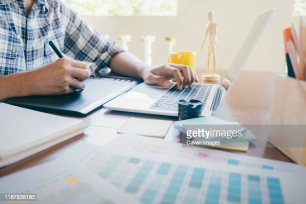 graphic design and color swatches and pens on a desk. - animator stock pictures, royalty-free photos & images