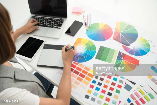graphic designer at work. color swatch samples. artist drawing something on graphic tablet at the office. graphic designer creativity editor ideas designer concept - design professional stock pictures, royalty-free photos & images
