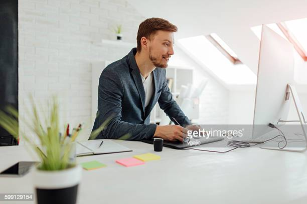 graphic designer at work. - illustrator stock photos and pictures