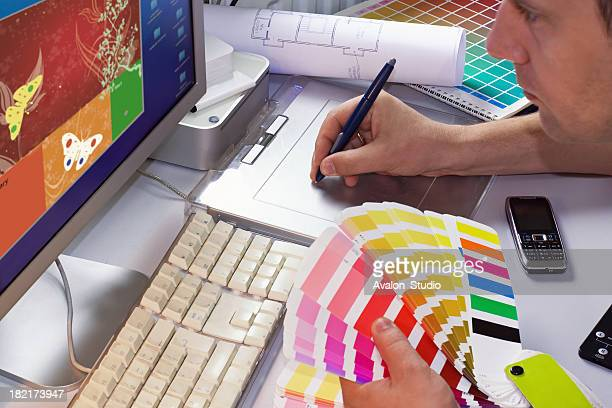 Graphic designer selects colors to project