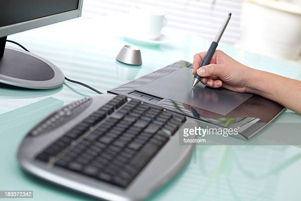 Graphic designer using digital tablet in the office