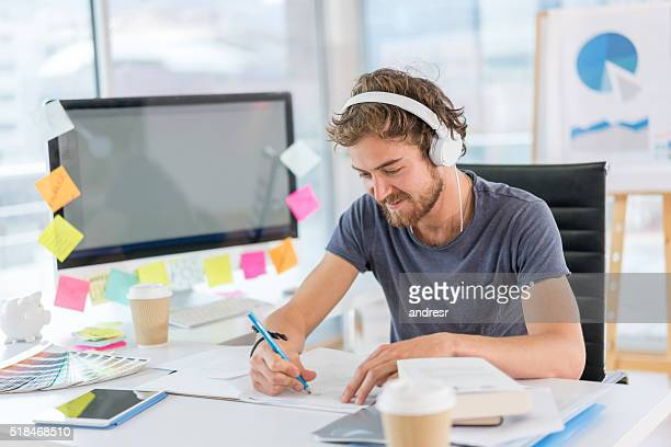 Graphic designer working and listening to music