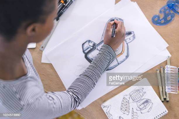 graphic designer working in modern studio space - illustrator stock photos and pictures
