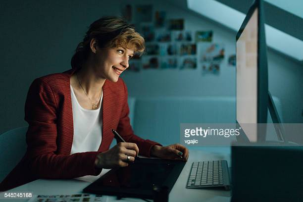 graphic designer working in office - illustrator stock photos and pictures