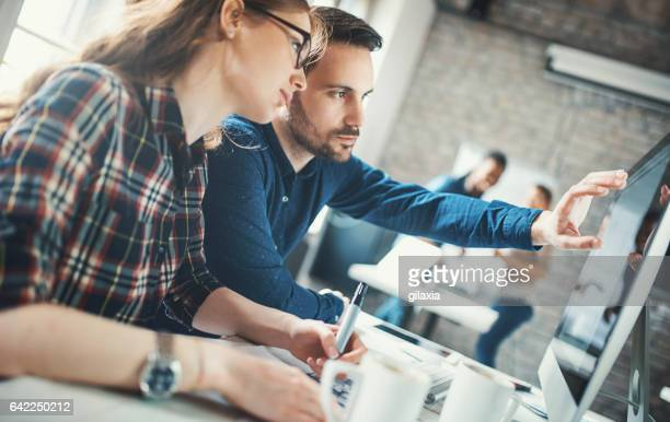 graphic designers at their studio. - showing stock photos and pictures