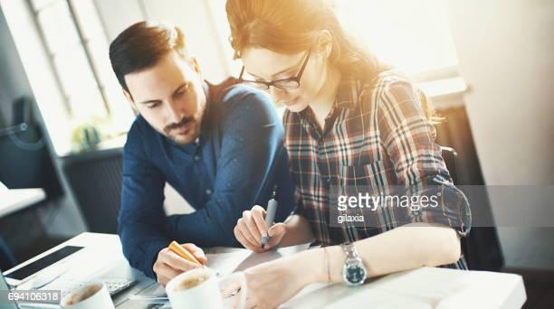 graphic designers at their studio. - gilaxia foto e immagini stock