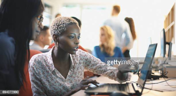 graphic designers at work. - black women stock photos and pictures