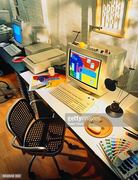 Graphic designer's desk in modern design studio, interior view