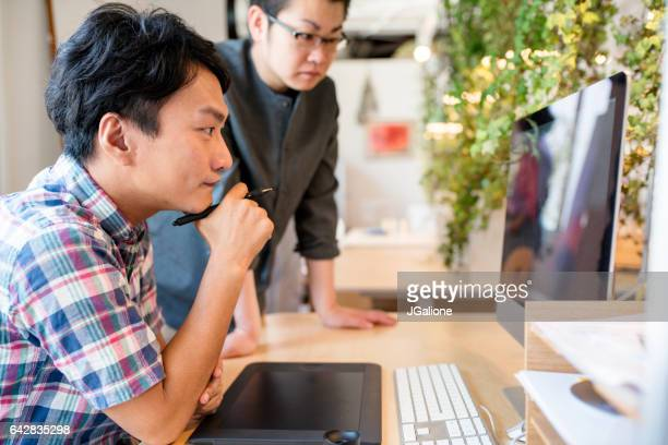Graphic designers looking at computer