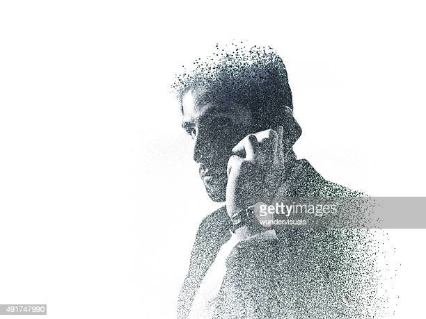 graphic image of businessman on the phone created with dots - fading stock pictures, royalty-free photos & images