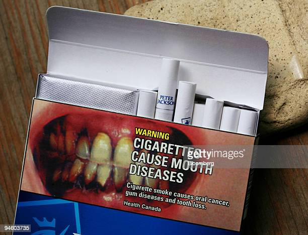 A graphic image warning label reading 'Cigarettes Cause Mouth Diseases' on a Peter Jackson cigarette box in Toronto Ontario Canada Thursday June 28...