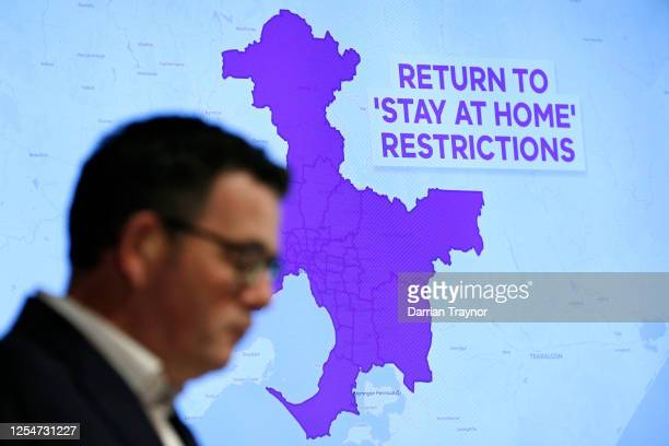 Graphic is seen showing the areas of Melbourne that will be required to go into lock down as Victorian Premier Daniel Andrews speak to the media on...
