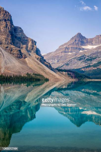 graphic reflections in bow lake,  banff national park, canada - canadian rockies stock pictures, royalty-free photos & images