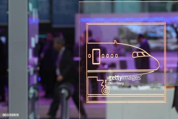 Graphic showing the front of an airliner sits on a screen at the TE Connectivity pavilion at the 2017 Aircraft Interiors Expo in Hamburg, Germany, on...