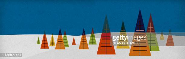 graphic trees in snow - christmas banner stock photos and pictures