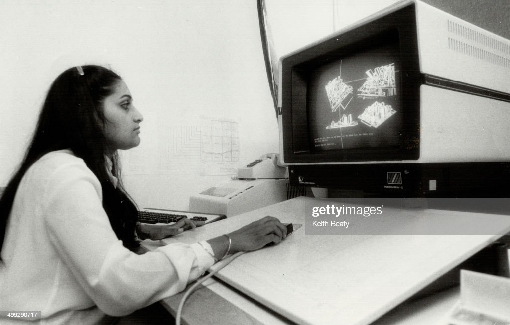 Graphic views Programmer Rekha Kapadia looks at 3D maps in a computer graphic system that Toronto is testing