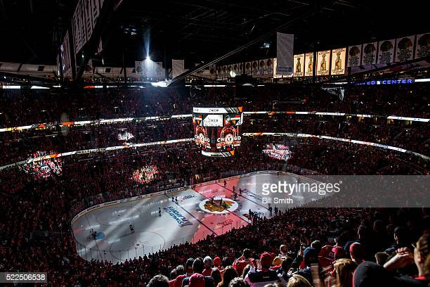 Graphics are projected onto the ice during the pregame ceremony for Game Four of the Western Conference First Round between the Chicago Blackhawks...