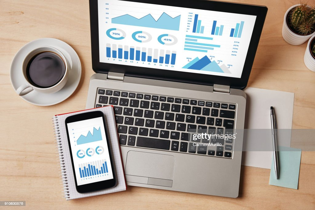 Graphs and charts elements on laptop and smartphone screen : Foto de stock