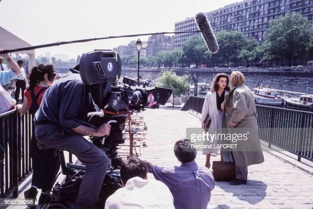 Gérard Depardieu et Maruschka Detmers lors du tournage du film 'Deux' réalié par Claude Zidi en juin 1988 à Paris France